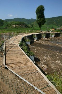 Bridge in Datan Village, Gansu. Photo: Wu Zhi Qiao (Bridge to China) charitable foundation.
