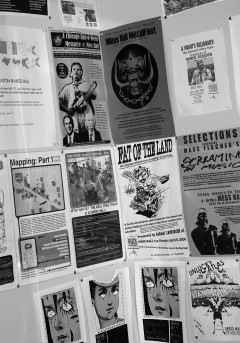 Posters from past events on Mess Hall bathroom walls, 2008. Photo: Justin Goh.