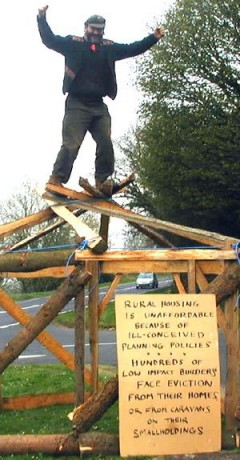 The Land is Ours campaigner on a reciprocal roof as part of the campaign to save roundhouses. Courtesy: TLIO