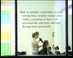 Mullet: Recycling working class culture – the window of a Hoxton hair dressers. Still from The London Particular. Image: David Panos & Ben Seymour, 2003